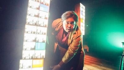 Charlotte Jones on stage mid-performance