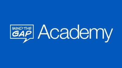 A blue background with a white Mind the Gap Logo and the word Academy next to it